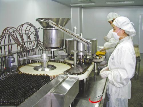 全自动小型口服液灌装机在生产线中的应用